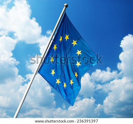 European Union flag on blue sky background - stock photo