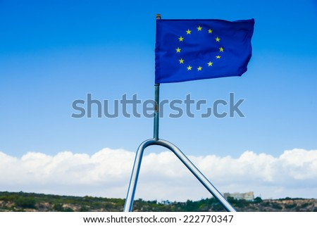 European Union flag on the ship developed in the wind - stock photo