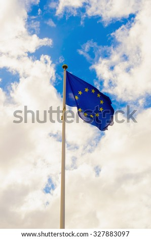 European union flag waving against a cloudy sky - stock photo