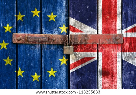 European Union flag with the UK flag on the background of old locked doors - stock photo