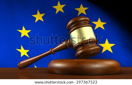 European Union law, legislation and parliament concept with a 3d render of a gavel on a wooden desktop and the EU flag on background. - stock photo