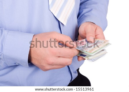 euros in a hands isolated on white - stock photo