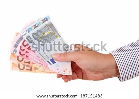 euros money in man hand - stock photo
