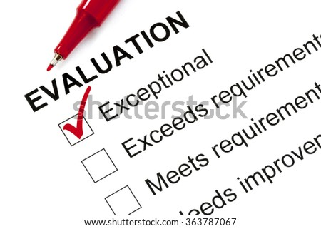 """Evaluation form marked """"exceptional"""" with red pen. - stock photo"""