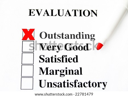 Evaluation with selective focus and shallow depth of field.  The focus is on the word outstanding. - stock photo