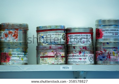 EVANSTON, IL: December 2015 - Cans of etching ink at art studio - stock photo