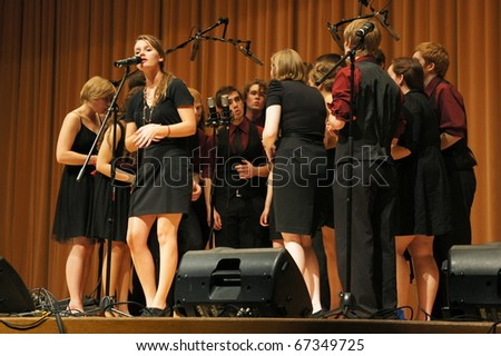 EVANSTON, ILLINOIS- NOVEMBER 13: A cappella singing group Redefined of the University of Wisconsin-Madison performs in The Best of the Midwest Concert on November 13, 2010 in Evanston, Illinois - stock photo