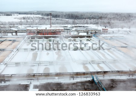 Evaporation from reservoirs with waste water at the plant - stock photo