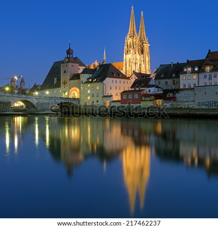 Eveinig view from Danube on Regensburg Cathedral and Stone Bridge in Regensburg, Germany - stock photo