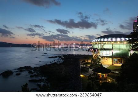 Evening at Dongbaek island in Busan, Korea with Gwanggali bridge in the far distance - stock photo