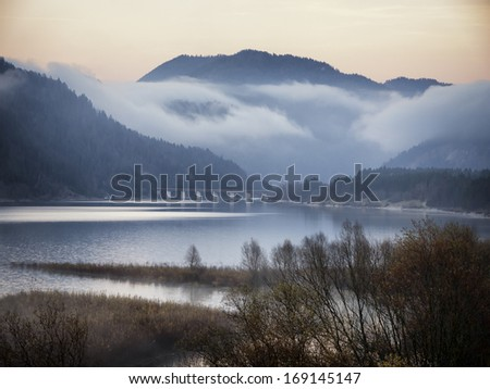 evening at the sylvensteinspeicher lake in germany - stock photo