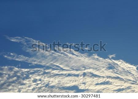 Evening blue sky clouds - stock photo