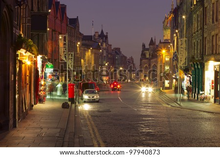 Evening city life in the centre of Edinburgh. The Royal Mile is a succession of streets which form the main thoroughfare of the Old Town of the city of Edinburgh in Scotland. - stock photo