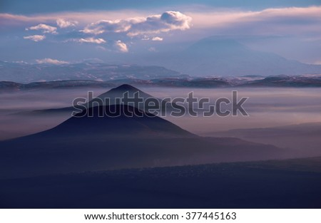 Evening in the Caucasian ridge and the mountains and purple haze - stock photo