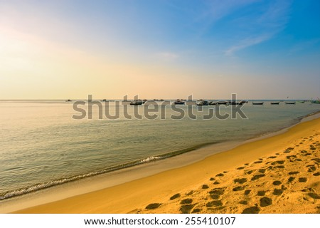Evening landscape on the background of coastal fishing boats near the shore of the island of Phu Quoc - stock photo