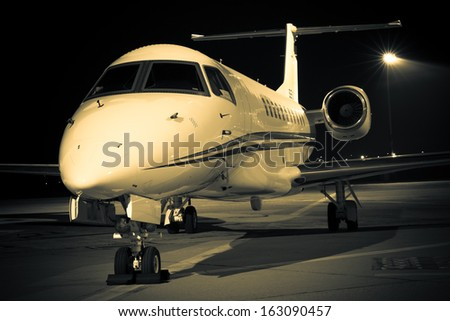 evening light aircraft at an airport - stock photo