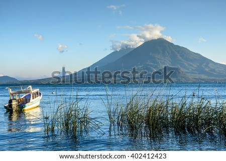Evening light on volcanoes Atitlan & Toliman on Lake Atitlan, Guatemala. - stock photo