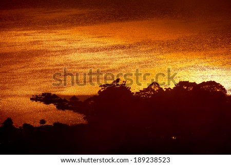 Evening light over the lake in Bali. - stock photo