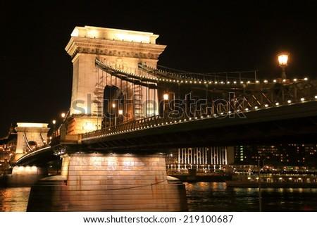 Evening lights on the Chain bridge across Danube river, Budapest, Hungary - stock photo