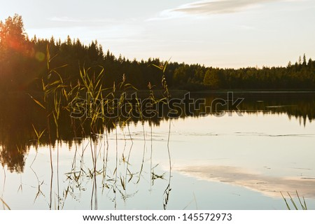 evening mood at a lake in finland - stock photo