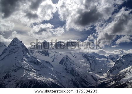 Evening Mountains and sulight clouds. Caucasus Mountains, ski resort Dombay. - stock photo