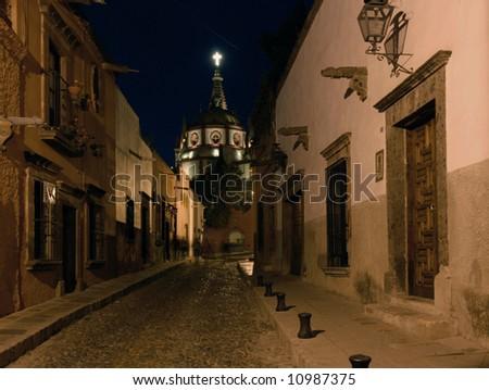 Evening on a cobblestone street in San Miguel de Allende, Mexico - stock photo