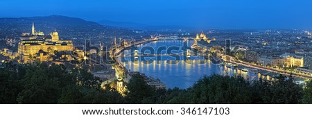Evening panorama of Budapest, view from Gellert Hill, Hungary. The panorama shows: Buda with Buda Castle, Danube river with Szechenyi Chain Bridge, Pest with Hungarian Parliament Building. - stock photo