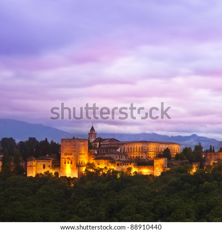 Evening panoramic view of Spain's main tourist attraction: ancient arabic fortress  of Alhambra, Granada, Spain. - stock photo
