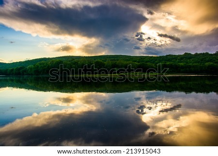 Evening reflections in the Delaware River, at Delaware Water Gap National Recreational Area, New Jersey. - stock photo