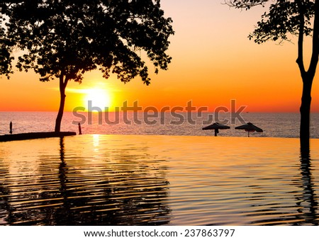 Evening Relaxation Sunset Pool  - stock photo
