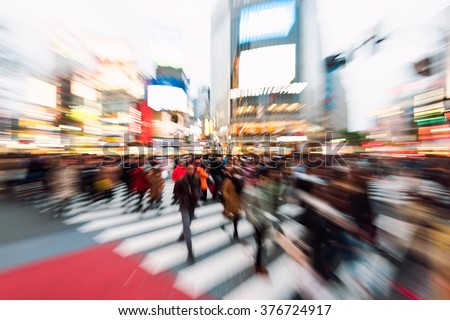 Evening rush hour at the famous Shibuya Crossing in Tokyo, Japan. This area is known as one of the fashion centers of Japan. - stock photo