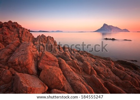 Evening scene with Tavolara Island in the east of Sardinia. - stock photo
