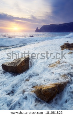Evening sea landscape with the setting sun and foaming waves. Crimea, Ukraine, Europe - stock photo