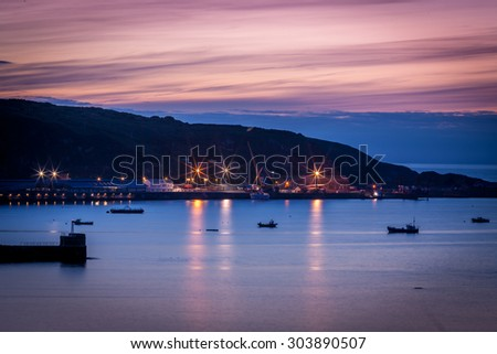 Evening shot of Fishguard, Pembrokeshire, Wales.  showing the harbor and hillside beyond. - stock photo