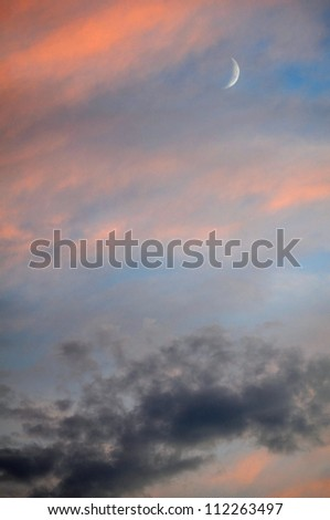 Evening Sky with Crescent Moon - stock photo