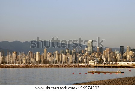 Evening skyline of vancouver with Vancouver bay and mountain-scape - stock photo