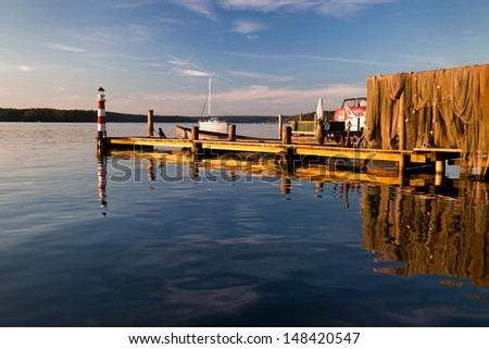 evening Sunset at a pier at Werbellinsee - stock photo