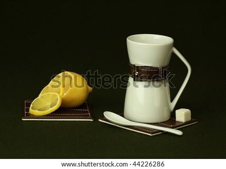 Evening tea with lemon creates a good mood - stock photo