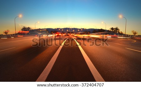 Evening traffic on the road, the view from the road - stock photo