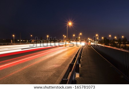Evening traffic with long exposure. - stock photo
