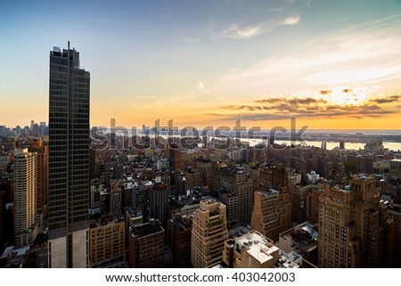 Evening view from a high building of Midtown, New York City with Hudson River - stock photo
