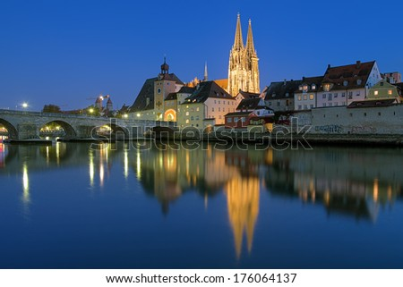 Evening view from Danube on Regensburg Cathedral and Stone Bridge in Regensburg, Germany - stock photo