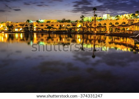 Evening view from sea for luxury hotel in night illumination  - stock photo