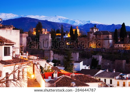 Evening view of  Alhambra with Sierra Nevada in  background.  Granada,  Spain - stock photo