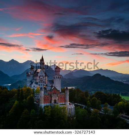 Evening view of Neuschwanstein Castle in Bavaria (Germany) with beautiful sunset sky - stock photo
