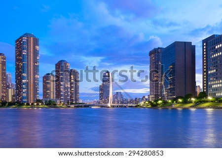 Evening View of Office Buildings and Highrise Mansion in Tokyo - stock photo
