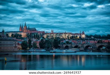 Evening view of old Prague and Vltava River - stock photo