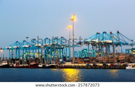 Evening view of  Port with cranes and containers - stock photo