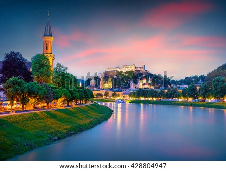 Evening view of Salzburg skyline, Festung Hohensalzburg (unesco heritage) and Salzach river. Colorful sunset in Austria, Europe. Artistic style post processed photo. - stock photo