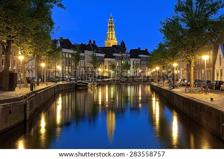Evening view of the Aa river (Drentsche Aa) with tower of the A-Church (Aa-Kerk) in Groningen, Netherlands - stock photo